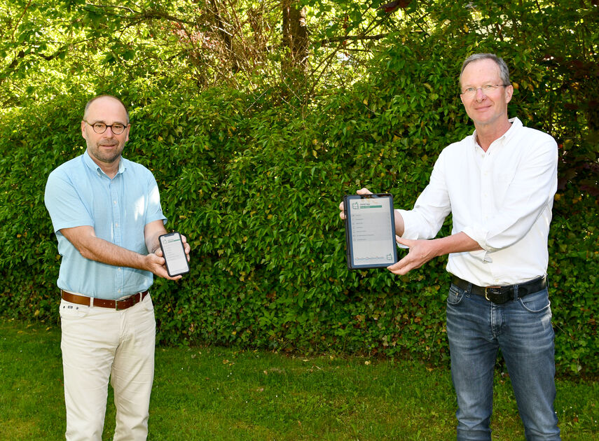 Michael Werner und Hubertus Abraham stellen die neue Abfall-App vor.